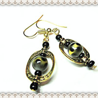 Spotted Leopard Earrings~Women's Beaded Earrings~Leopard Look Bead In An Oval Gold Frame~Black Bead Accents~On Hooks