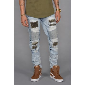 Distressed Patched Moto Jeans in Light Indigo