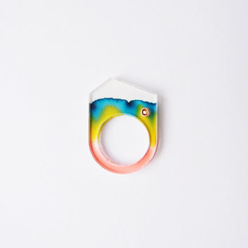 ombre chromatography mountain peak ring . iridescent red blue yellow . acrylic cover