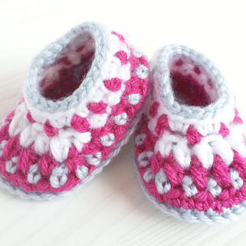 Multicolored, patterned, smooth, crocheted baby shoes