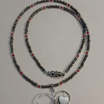 Silver heart with hematite and swarovski crystal on beaded necklace.