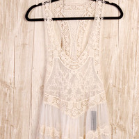 Channel your inner bohemian with this All About The Crochet & Lace Tank Top! This sleeveless tank top features semi-sheer crochet and lace throughout, deep v-neckline, racer back, low arm-hole, flare bottom and finish with scallop crochet & lace hemline. P