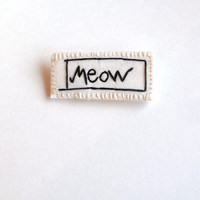 Hand embroidered brooch for cat lovers on cream muslin with cream felt backing An Astrid Endeavor party favors MEOW