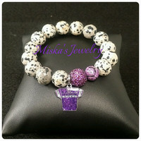 NFL Bracelet Unisex 12mm Dalmatian Spotted Jasper Gemstone/Beads w/ a Baltimore Ravens Charm, Agate Bead and an Alloy Spacer.