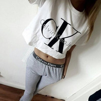 "[ On Sale ] ""Calvin Klein Jeans"" Letter and Logo like Print Short Bare Midriff Sleeve Women Casual Sweatshirt Shirt Top Blouse T-Shirt and Sweatpants Set (2 pc) _ 1861"