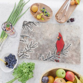 The Red Cardinal in winter Cutting Board by savousepate