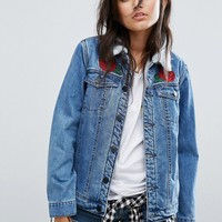 Santa Cruz Oversized Sherpa Lined Denim Jacket With Rose Applique at asos.com