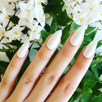 Gloss white stiletto nails, hand painted acrylic nails, fake nails, false nails, stick on nails, nail art, nail designs, artificial nails
