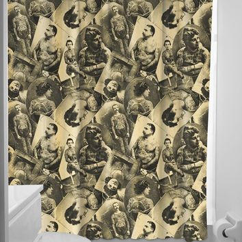 This great Sourpuss shower curtain reminds us of a time when only those in the Military or Outlaws were getting tattooed. This polyester shower curtain comes with rings included.