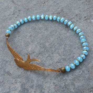 sparrow bangle, Something blue, vintage brass sparrow, light blue crystal and African trade beads