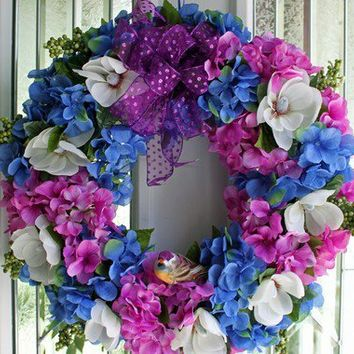 Spring Blue and Purple Hydrangeas, white flowers green berries, purple bow and cute little matching bird