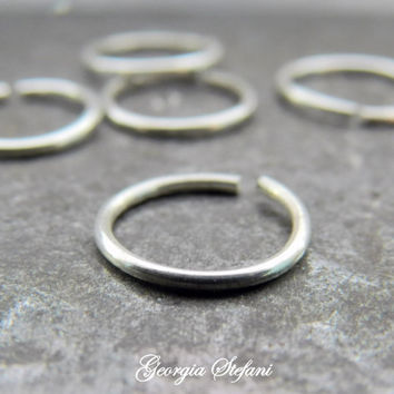 One 6mm 20 gauge endless hoop earring.22 gauge endless hoop earring. 6mm cartilage hoop. Tragus earring.Eyebrow hoop. Mens earring. Piercing