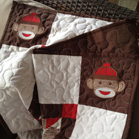 Sock monkey crib set with quilt, crib sheet, and bedskirt