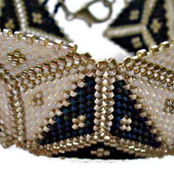 White, navy and silver beaded cuff bracelet. Geometric triangle beadwoven bracelet