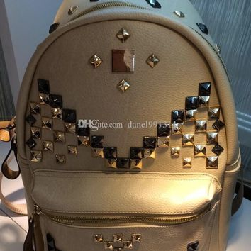 2017 hot sale mM family letter rivet studs leather backpack shoulder bag school bag size small and medium free shipping more sty