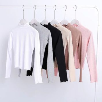 FREE SHIPPING  Early autumn new style slender body petals tightly embossed high waist long sleeve T-shirt sole shirt