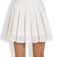 Pleated Eyelet Mini Skirt