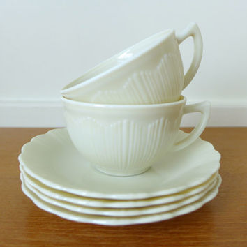 Two Macbeth Evans Cremax ivory teacups with four saucers