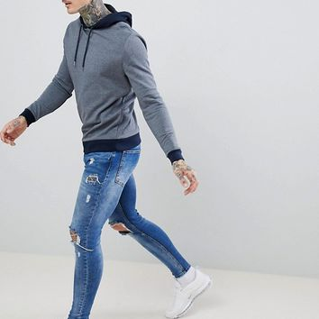 ASOS DESIGN hoodie in navy marl with contrast tipping at asos.com