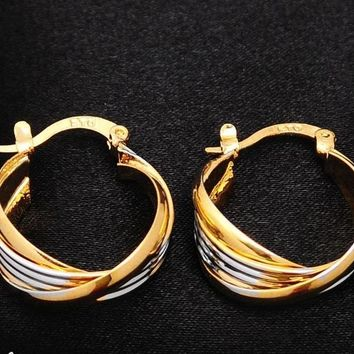 Classic gold and silver twisted small hoop earrings
