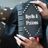 SPELLS AND POTIONS LEATHER BOOK CLUTCH