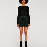 SUEDE MINI SKIRT DETAILS