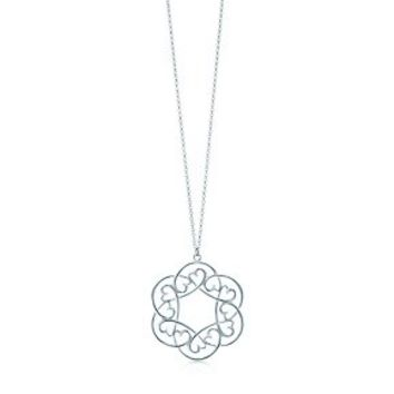 Tiffany & Co. -  Paloma Picasso® Loving Heart swirl pendant in sterling silver.