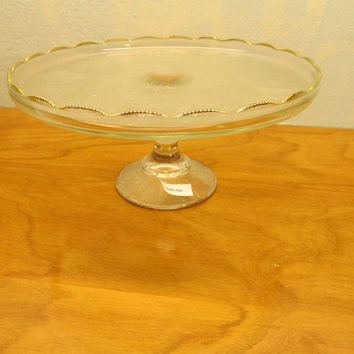 JEANNETTE GLASS PEDESTAL CAKE PLATE WITH MUSICAL HARP DESIGN