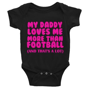 My Daddy Loves Me More Than Football and That's a Lot Infant Bodysuit