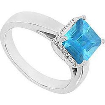 Blue Topaz and Diamond Ring : 14K White Gold - 0.83 CT TGW