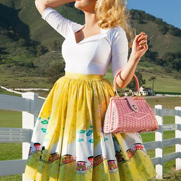 Pinup Couture Jenny Skirt in Mary Blair Yellow Train Border Print