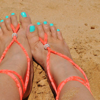 Barefoot Sandals in sunburned neon orange jersey knit fabric with silver colored wire mesh beads