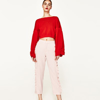 FLOWING FRILLED TROUSERS DETAILS