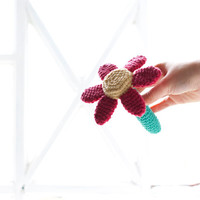 Amigurumi flower rattle. Soft toy flower, teething toy for babies. Crocheted in certified organic eco cotton. Red, yellow and green.