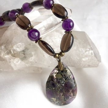 Purple, brown & gold amethyst and smoky quartz pendant necklace. Simple, dainty and elegant handmade jewelry with pyrite.