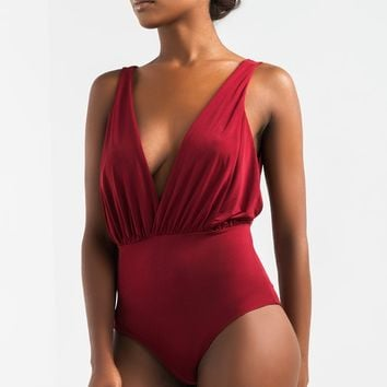 AKIRA Plunging Neckline Snap Close Bodysuit in Burgundy, Black