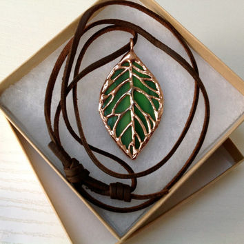 Stained glass green filigree leaf pendant with leather cord