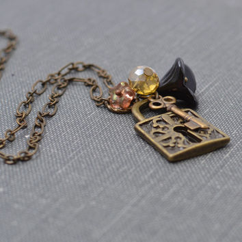 Antiqued Brass Necklace Charm Necklace with Lock, Skeleton Key and Black Czech Glass Bell Flower Bead Handmade Necklace