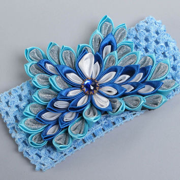 Handmade designer headband with stretch basis and volume blue kanzashi flower
