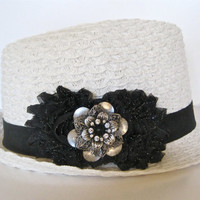 White Packable Fedora with Black Glitter Chiffon Flowers and a Silver and Black Rhinestone Pendant Accent