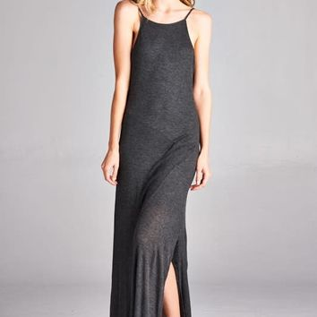 "This simple dress features a ribbed knit fabrication, scoop neckline, thin spaghetti straps, and a slit on the side. Finished with a maxi-length hemline. Partially lined with matching material ( From top to 1"" before side slit). Pair with gladiator sandals"