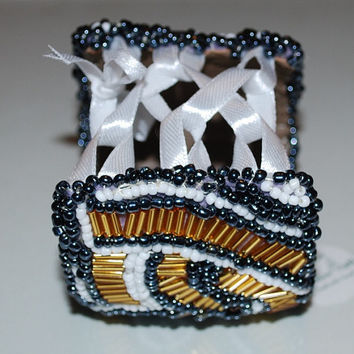 statement bracelet embroidered on felt