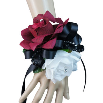 Wrist corsage:Burgundy Open rose with white and black ribbon