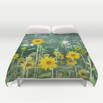 Sunflowers in the forest Duvet Cover by Guido Montañés