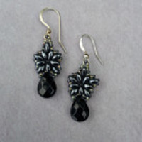 Black and Hemitite woven earrings. Star shaped with a teardrop. hand woven 1 inch in length. sterling ear wires. Made in The Dalles, Oregon