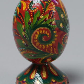 Handmade beautiful painted egg made of wood handcrafted using special technique