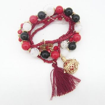 VidaLuxe™ Essential Oil Charm Bracelet Stack (red w/ tassel)