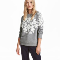 H&M Sweatshirt with Appliqués $34.99