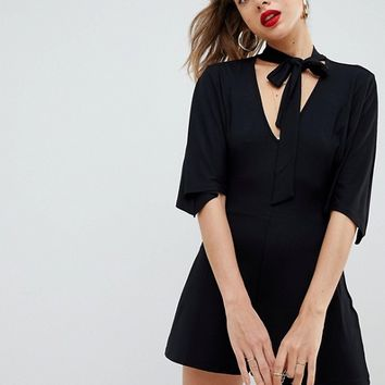 ASOS Design romper with tie neck and kimono sleeve at asos.com