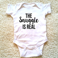 The snuggle is real graphic baby clothing for newborn, 6 months, 12 months, and 18 months